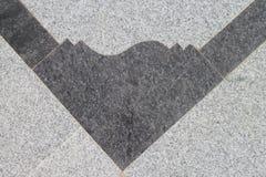 Umgekehrter abstrakter Entwurf auf Marmorboden Stockfoto