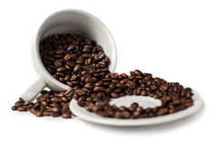 Umgekehrtes Cup mit Kaffeebohnen Lizenzfreie Stockbilder