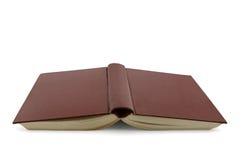 Umgekehrtes offenes Buch lokalisiert auf Weiß Stockfotografie