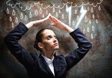 Umgekippte Geschäftsfrau Stockfotografie
