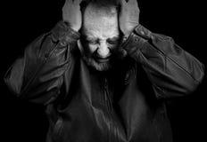Umgekippter älterer Mann Stockfotografie