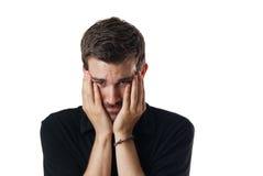 Umgekippter besorgter junger Mann Lizenzfreies Stockfoto