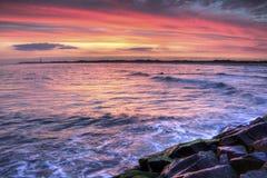 Umhang mag Sonnenuntergang Lizenzfreie Stockfotografie
