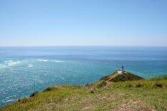 Umhang Reinga Leuchtturm, Neuseeland Stockbilder