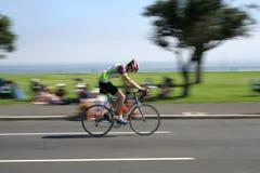 Umhangargus-Radfahrer Stockbild