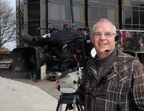 Uśmiechać się TV kamerzysty Fotografia Stock