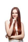 Uśmiechnięta czerwona z włosami dziewczyna Obrazy Royalty Free