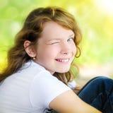 Uśmiechnięta śliczna mała dziewczynka Fotografia Stock