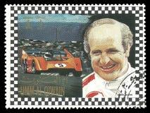 Racing driver Denis Clive Hulme. Umm al Quwain - circa 1972: Stamp printed by Umm al Quwain, Color edition on Car Racing, shows Racing driver Denis Clive Hulme Royalty Free Stock Image