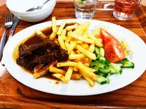 Ummy fries and beef. For dinner Royalty Free Stock Photography