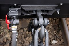 ?umper and coupler - hang rail car .Freight cargo train - black cars wagons. New 6-axled flat wagon ,Type: Sahmmn, Model WW 60. ?umper and coupler - hang rail Stock Photos
