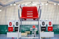 Umpire chair with scoreboard on a tennis court before the game. Stock Image