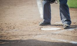 Umpire about to brush the plate stock photography