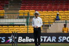 Umpire Rajesh Deshpande. Cricket umpire Rajesh Deshpande officiates in the ongoing Irani Cup match in Bengaluru Stock Photography