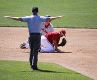 The umpire signals safe