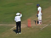 Umpire Singnaling out to a Batsman in Cricket Matc Stock Photos