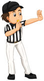 Umpire in striped uniform blowing whistle Royalty Free Stock Photos