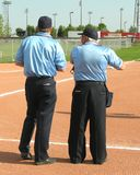 Umpires. Two umpires waiting for a ball game to begin Stock Photography