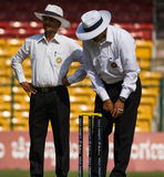 Umpires inspect. Cricket umpires Rajesh Deshpande and Vineet Kulkarni inspect the proceedings Stock Photography