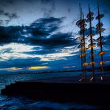 Umrellas in the port. Art in a Greek town Royalty Free Stock Image