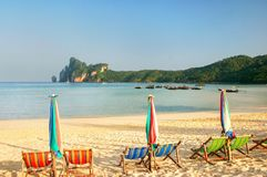 Umrellas and sunchairs at Ao Loh Dalum beach on Phi Phi Don Isla. Nd, Krabi Province, Thailand. Koh Phi Phi Don is part of a marine national park Royalty Free Stock Images