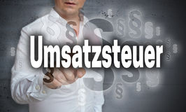 Umsatzsteuer in german Sales tax is shown by man concept Royalty Free Stock Images