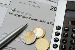 Umsatzsteuer-Voranmeldung. German tax form Umsatzsteuer-Voranmeldung with euro coins, calculator and pen Stock Photos