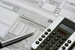 Umsatzsteuer-Voranmeldung. German tax form Umsatzsteuer-Voranmeldung with calculator and pen Royalty Free Stock Photos