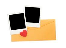 Umschlag und sofortige Fotos Stockfotos