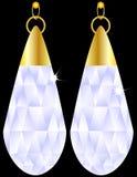 Un accoppiamento degli orecchini del diamante Fotografie Stock