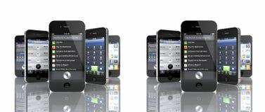 Un'accumulazione del iPhone 4S di 5 Apple Fotografie Stock Libere da Diritti