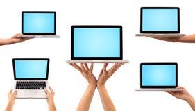 Un'accumulazione di cinque computer portatili Fotografia Stock