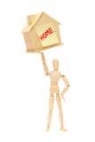 Un adeguamento verso l'alto di legno della persona una casa o una casa immagini stock
