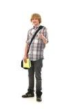 Un adolescente caucásico feliz que detiene los pulgares Fotografía de archivo