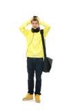 Un adolescente che tiene la sua testa come è nella difficoltà Fotografia Stock Libera da Diritti
