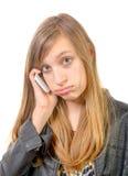 Un adolescente con un teléfono celular Foto de archivo libre de regalías