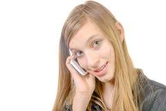 Un adolescente con un teléfono celular Fotografía de archivo libre de regalías