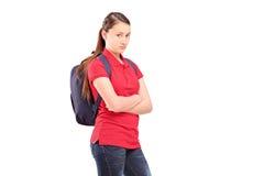 Un adolescente femenino triste con una mochila Imagen de archivo libre de regalías
