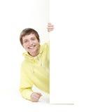 Un adolescente que sostiene una bandera blanca Fotos de archivo libres de regalías