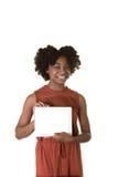 Un adolescente que sostiene una tableta Imagenes de archivo