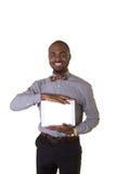 Un adolescente que sostiene una tableta Fotos de archivo libres de regalías