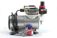 Un aerógrafo y un generador Foto de archivo