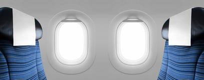 Un aereo in bianco di due finestre con i sedili blu Fotografia Stock Libera da Diritti