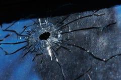 Un agujero de punto negro está en vidrio Fotografía de archivo libre de regalías