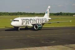 Un Airbus A319 da Frontier Airlines Fotografie Stock