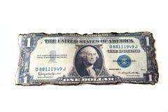 Un aislante del dólar en el fondo blanco Imágenes de archivo libres de regalías