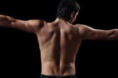 Un ajuste, parte posterior muscular del varón, con la piel toasty agradable Imagen de archivo libre de regalías