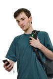 Un allievo con uno smartphone Fotografie Stock