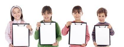 Un allievo dei quattro bei bambini Fotografie Stock Libere da Diritti