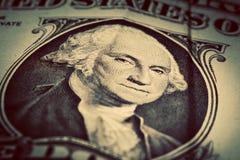 Un alto vicino della banconota in dollari Fuoco sugli occhi di George Washington Immagine Stock Libera da Diritti